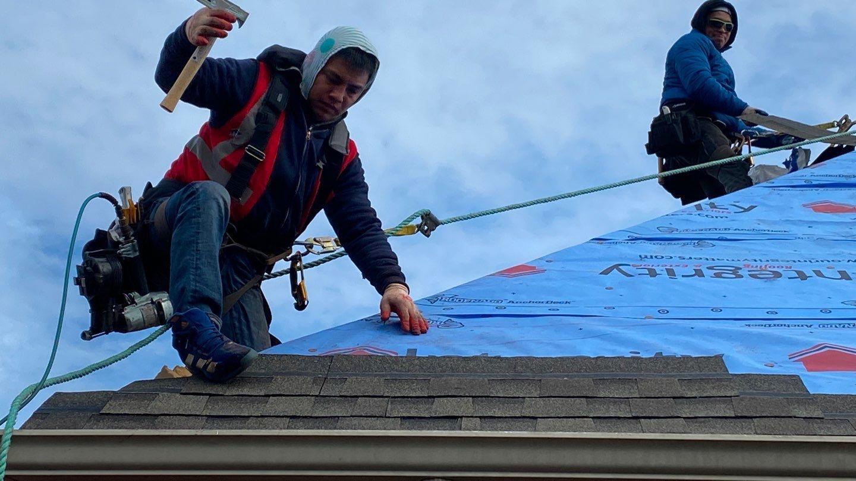 Integrity Roofing team completing roof repair